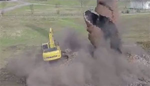 Chimney Collapses On Tractor